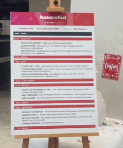 MeasureFest Agenda sign with talks at times