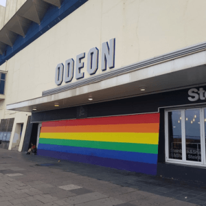 Odeon in Brighton with huge horizontal rainbow flag outside